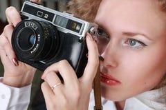 Woman photographer. Holding camera. Fashion royalty free stock photography