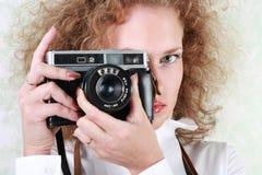 Woman photographer. Holding photo-camera stock photography