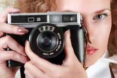 Woman photographer. Holding photo-camera stock image