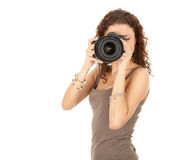 Woman photographer in action Royalty Free Stock Photography