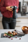 Woman photographer with autumn fruits and vegetables Stock Images