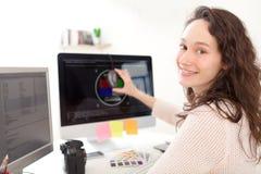Woman photographer calibrate her screen Stock Photos