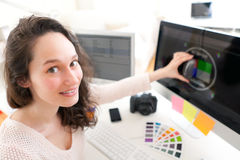 Woman photographer calibrate her screen Royalty Free Stock Images