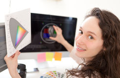 Woman photographer calibrate her screen Stock Photography
