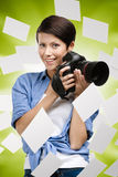 Woman-photographer with camera and flying photos Royalty Free Stock Photo
