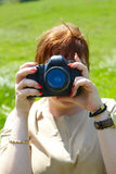 Woman photographer with camera Royalty Free Stock Photos