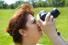 Woman photographer with camera Stock Photo