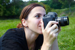 Woman photographer with camera Stock Images