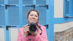 Woman photographer with camera on the street. stock video footage