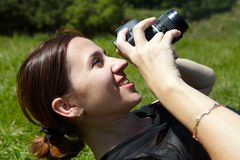 Woman photographer with camera. Woman photographer and reflex camera. Beautiful young photographer Stock Photo