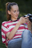 Woman photographer checking pictures Royalty Free Stock Images