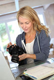 Woman photographer checking shots Royalty Free Stock Photography