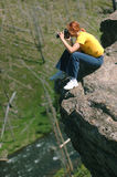 Woman photographer on the cliff. At Yellowstone Royalty Free Stock Image