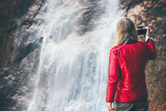 Woman photographer enjoying waterfall view Stock Photography