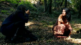 Woman photographer with female model in forest stock video