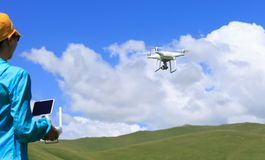 Woman photographer flying drone. Outdoors Stock Images