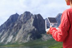 Woman photographer flying drone outdoors. Asian woman photographer flying drone outdoors Royalty Free Stock Photos