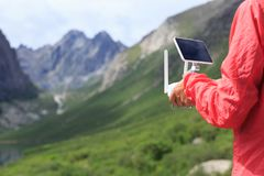 Woman photographer flying drone outdoors. Asian woman photographer flying drone outdoors Royalty Free Stock Image