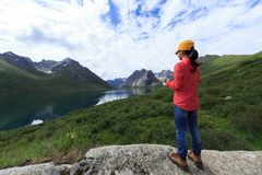 Woman photographer flying drone outdoors. Young woman photographer flying drone outdoors Stock Photo