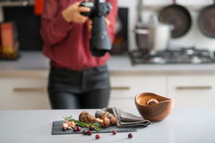 Woman photographer focuses lens autumn fruits and vegetables Stock Photo