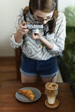 Woman Photographer Food Croissant Photography Concept stock images