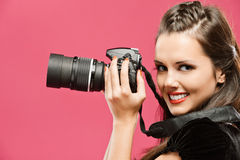 Woman-photographer hold in hands Stock Photo