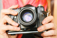 Woman photographer holding 35mm film camera. Royalty Free Stock Photos