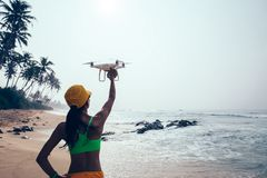 Woman photographer landing or taking off a drone royalty free stock photos