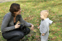 Woman photographer and a little boy Royalty Free Stock Image