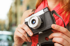 Woman photographer with lomo camera. Stock Image