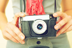 Woman photographer with lomo camera. Royalty Free Stock Images