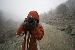 Woman photographer in the moutains Royalty Free Stock Photo