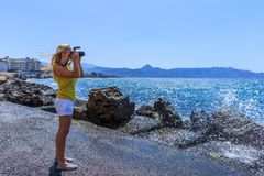 Woman photographer Nature photographer shooting the sea. Travel Concept stock images