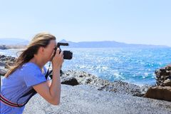 Woman photographer Nature photographer shooting the sea. Travel Concept royalty free stock photo