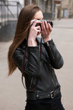 Woman photographer. Old school electronics Royalty Free Stock Photography