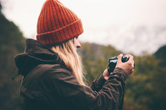 Woman photographer with photo camera shooting mountains Stock Photography