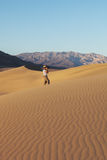 Woman photographer photographing sand waves Royalty Free Stock Photo