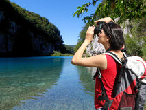 Woman photographer in Plitvice Lakes National Park Royalty Free Stock Photo