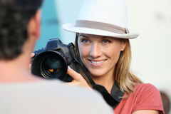 Woman photographer with a reflex camera shooting portraits Royalty Free Stock Images