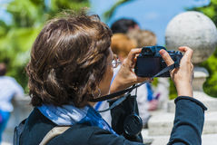 Woman photographer rome. Lady looking for a panoramic photo of rome Stock Image