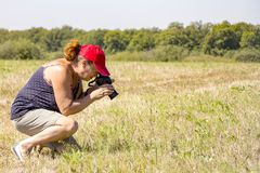 Woman photographer shoots nature Stock Image