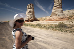 Woman photographer smiling and taking a photo of Elephant Foot Stock Photos