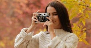 Woman photographer take a photo of the autumn nature. Woman photographer take a photo of the beautiful autumn nature stock video footage