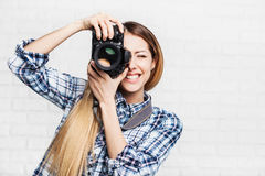 Woman photographer takes images with dslr camera. Attractive woman photographer takes images with dslr camera Royalty Free Stock Images