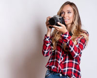Woman-photographer takes images,  on white Stock Photos