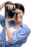 Woman-photographer takes photos Stock Photography