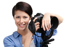 Woman-photographer takes shots Royalty Free Stock Photo