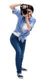 Woman-photographer takes snaps Stock Photo