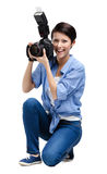 Woman-photographer takes snapshots Royalty Free Stock Photos