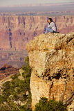 Woman photographer taking last pictures at the South Rim Royalty Free Stock Photos